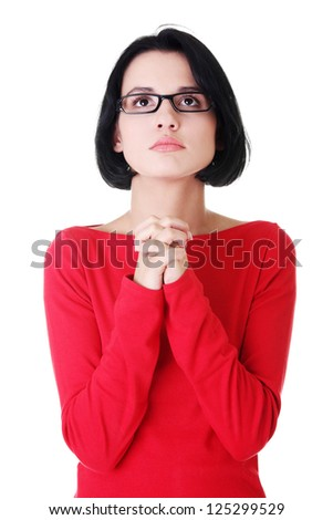 Young caucasian woman praying and looking up - stock photo