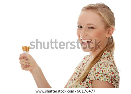 Young caucasian woman quiting smoking isolated - stock photo