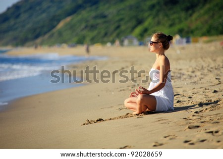 Young caucasian woman relaxing on the beach - stock photo