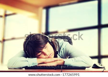 Young caucasian woman sleeping on keyboard - stock photo