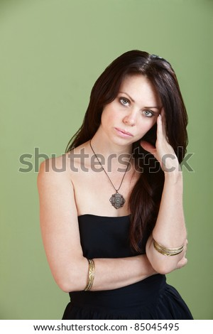 Young Caucasian woman suffers from symptoms of PMS - stock photo