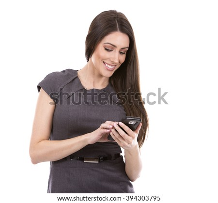young caucasian woman using her cellphone on white background