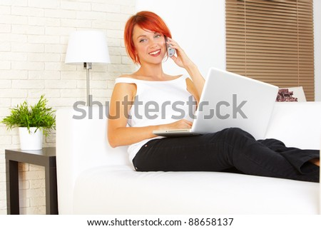 young caucasian woman using laptop at home - stock photo