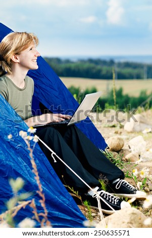 Young Caucasian woman using Laptop on nature. - stock photo