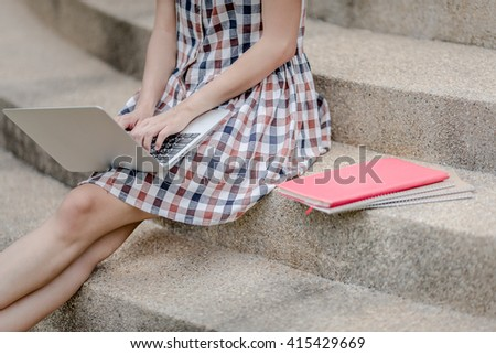Young Caucasian woman using Laptop on nature