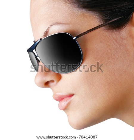Young caucasian woman wearing sunglasses, profile isolated on white - stock photo