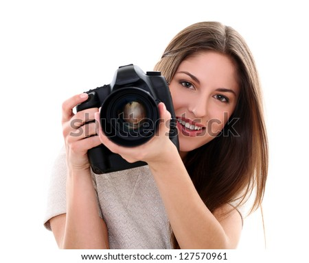 Young caucasian woman with camera isolated over white background - stock photo