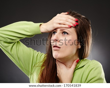Young caucasian woman with flu and a severe throat pain, coughing - stock photo