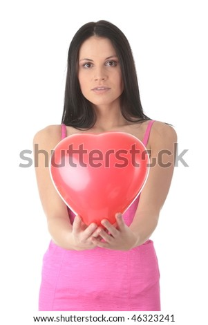 Young caucasian woman with heart shaped balloon