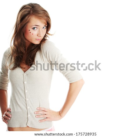 Young caucasian woman with light make up and hearts on face isolated on white background
