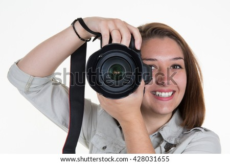 Young caucasian woman with professional camera in her hand