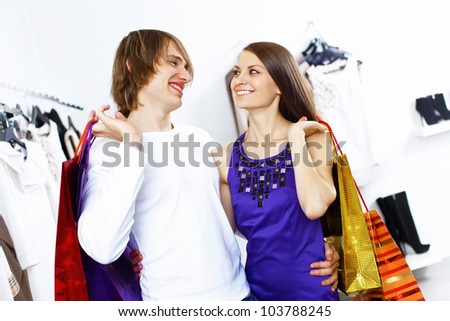 Young caucausian couple doing clothing shopping together