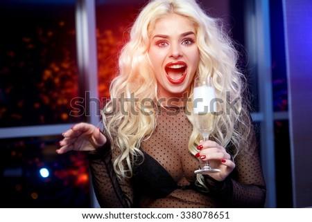Young celebrating woman black dress . Beautiful model  hold wine glass. - stock photo