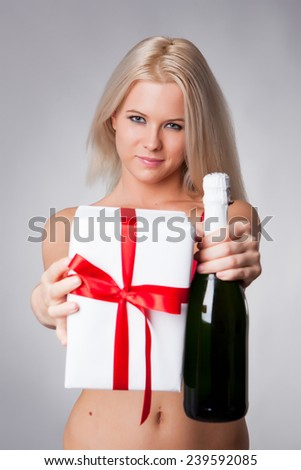 Young celebrating woman in lingerie. Beautiful model portrait isolated over studio background hold wine glass.  - stock photo