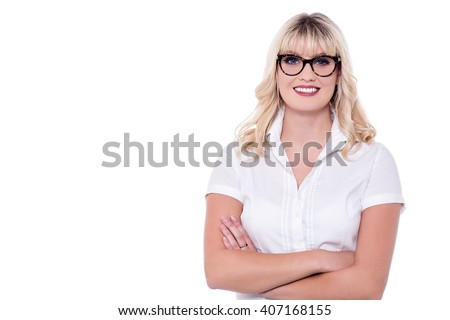 Young charming business lady, arms crossed. - stock photo