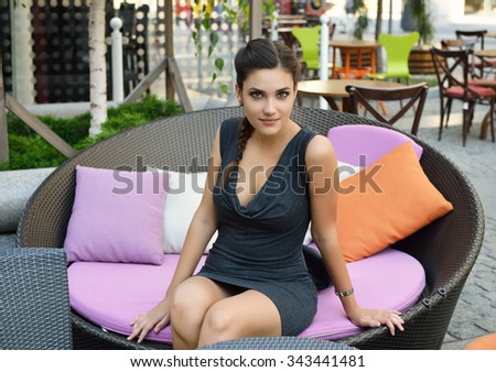 Young Charming Smiling Woman Relaxing in Open-air Cafe. Urban Lifestyle.  - stock photo