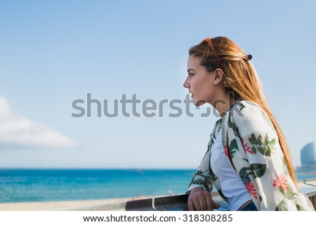 Young charming woman enjoy sea landscape while standing against calm sky background with copy space area for your text message or advertising content,thoughtful female rest after walking on the coast  - stock photo