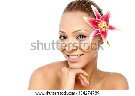 Young charming woman with pink flower