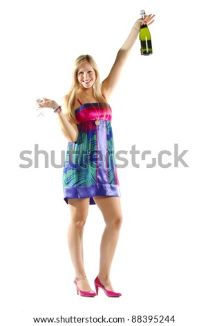 Young cheerful blond celebrating with a bottle of champagne on white background - stock photo