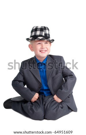 Young cheerful boy sitting on his knees on white background