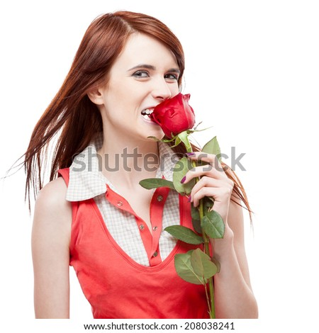young cheerful casual caucasian brunette woman biting red roses. isolated on white - stock photo