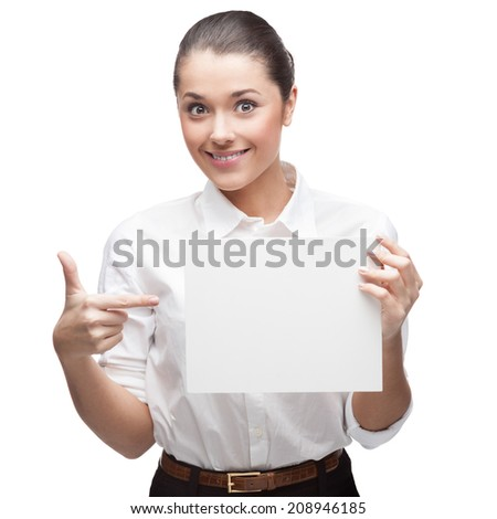 young cheerful caucasian brunette businesswoman in white blouse holding sign isolated on white