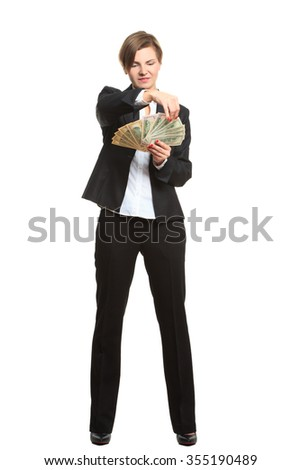 young cheerful caucasian businesswoman in black suit holding money isolated on white - stock photo