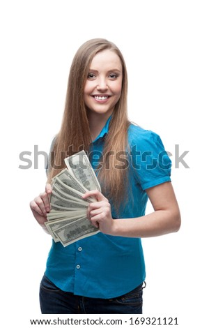 young cheerful caucasian businesswoman in blue blouse holding money isolated on white