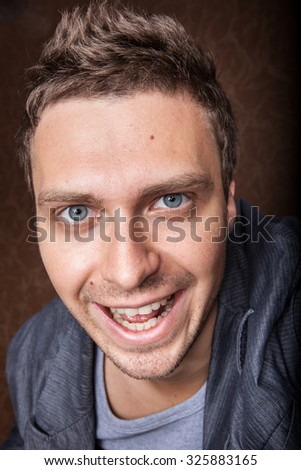 Young cheerful caucasian man with blue eyes