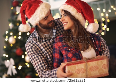 Young cheerful couple love gift christmas stock photo 725615221 young cheerful couple in love with gift for christmas negle Choice Image