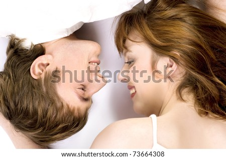 Young cheerful couple touched one another's nose - stock photo