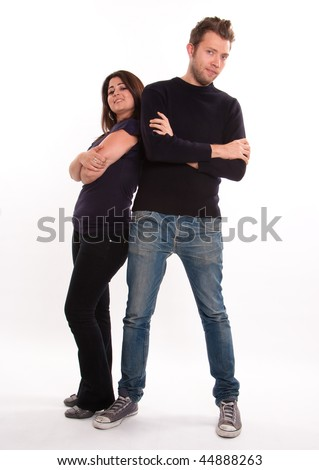 Young cheerful couple with contrasted heights isolated on white .