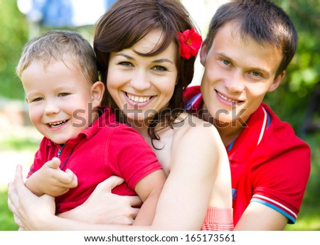 Young cheerful family outdoors