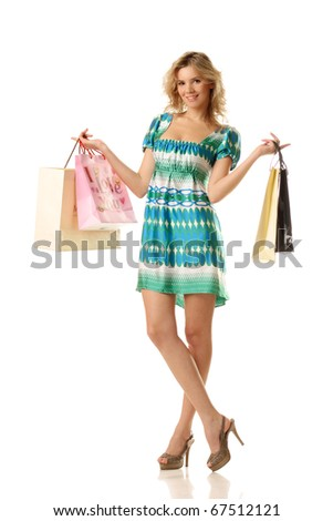 young cheerful female with blank shopping bags looking at you