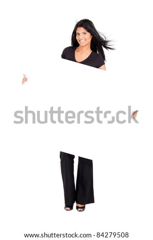 young cheerful indian woman holding white board - stock photo