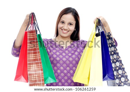 Young Cheerful Indian woman with shopping bags - stock photo