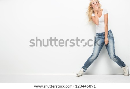 Young cheerful lady over empty white board - stock photo