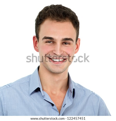 Young cheerful man in blue shirt and jeans, portrait of attractive guy looking at camera over white background