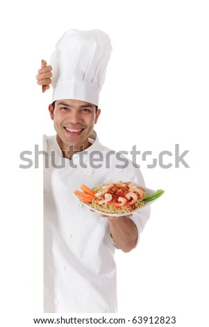 Young cheerful nepalese chef male holding a plate with tasty oriental food. Studio shot. White background.