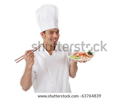 Young cheerful nepalese chef male holding shop-sticks and a plate with tasty oriental food. Studio shot. White background. - stock photo