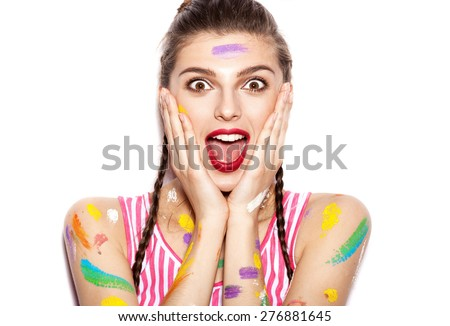 Young cheerful soiled in paint girl having fun. Smiling Woman with bright makeup and hairstyle with pigtails. White background not isolated - stock photo
