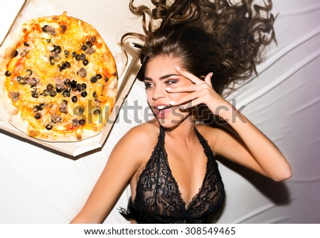 Young cheerful soiled in paint girl having fun.Smiling Woman with bright makeup and hairstyle with pigtails.White background not isolated.girl eating tasty pizza,fast-food take away home,eating pizza - stock photo