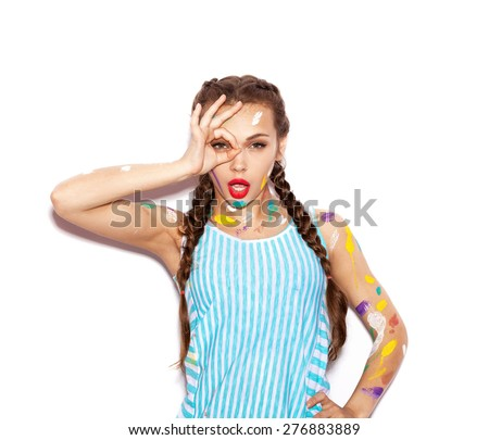 Young cheerful soiled in paint girl having fun. Woman with bright makeup and hairstyle with pigtails. White background not isolated - stock photo