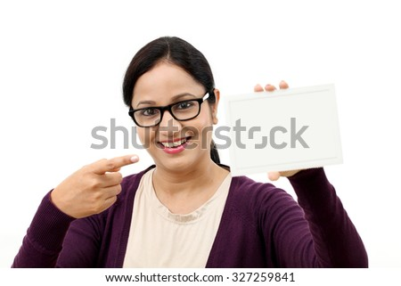 Young cheerful woman holding blank card - stock photo