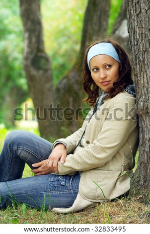 Young cheerful woman in a park