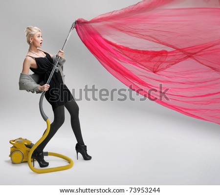 Young cheerful woman with vacuum cleaner, isolated on white - stock photo