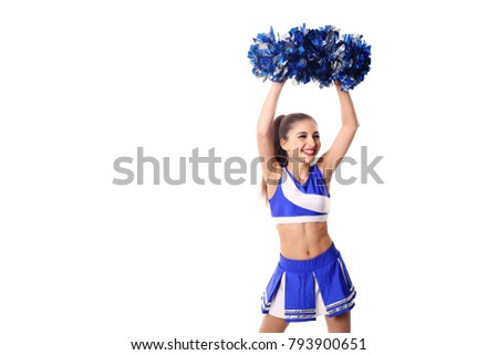 Young cheerleader in blue and white suit with pompoms on white background. Isolated on white background.