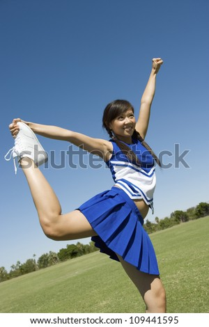 Young cheerleader performing on field