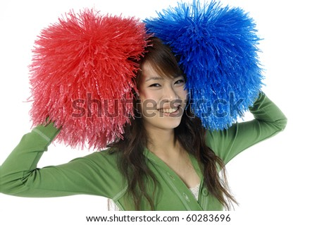 Young cheerleader with red and blue pom-poms smiling at camera isolated - stock photo