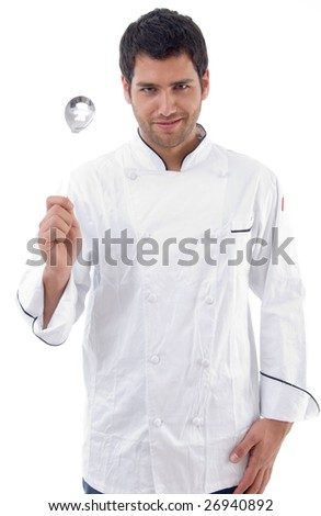 young chef holding slotted spoon against white background - stock photo